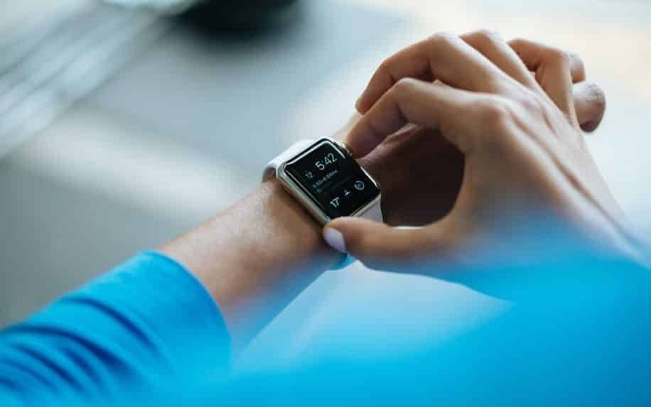 person checking their digital watch after a workout