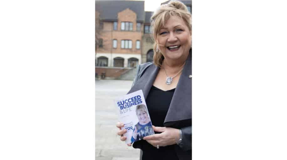 Bernie Allen holding her book