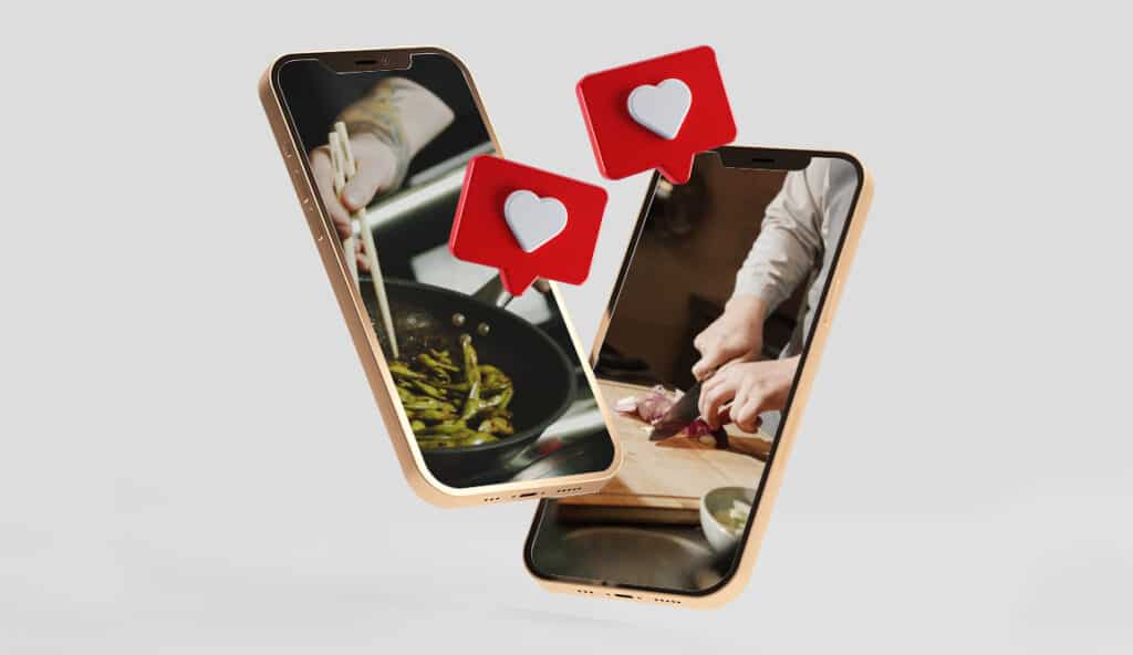 Two phones showing people cooking with small red hearts floating above to resemble Instagram 'likes'