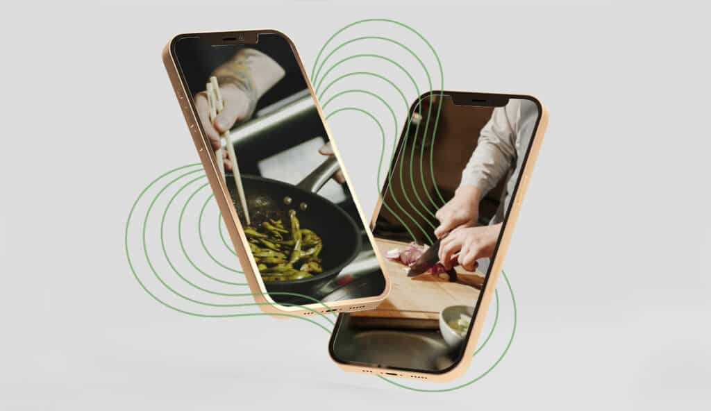 Grey background with two phones hovering. One showing a person cooking with a pan, another showing a person chopping up food.
