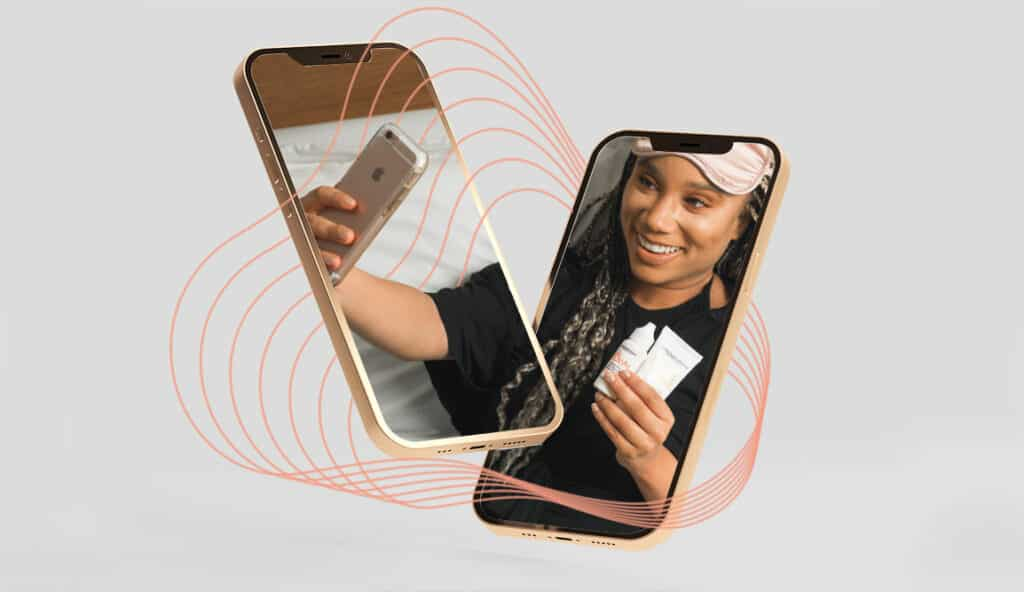 Grey background with two phones hovering with split vision of a woman taking a selfie with skincare products
