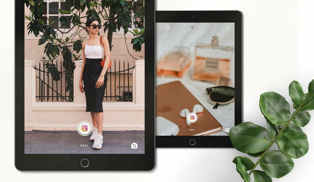 Flat lay of two tablets - one showing a well-dressed female blogger, the second showing a blurred picture of accessories. On the right-hand side, a green plant stem.