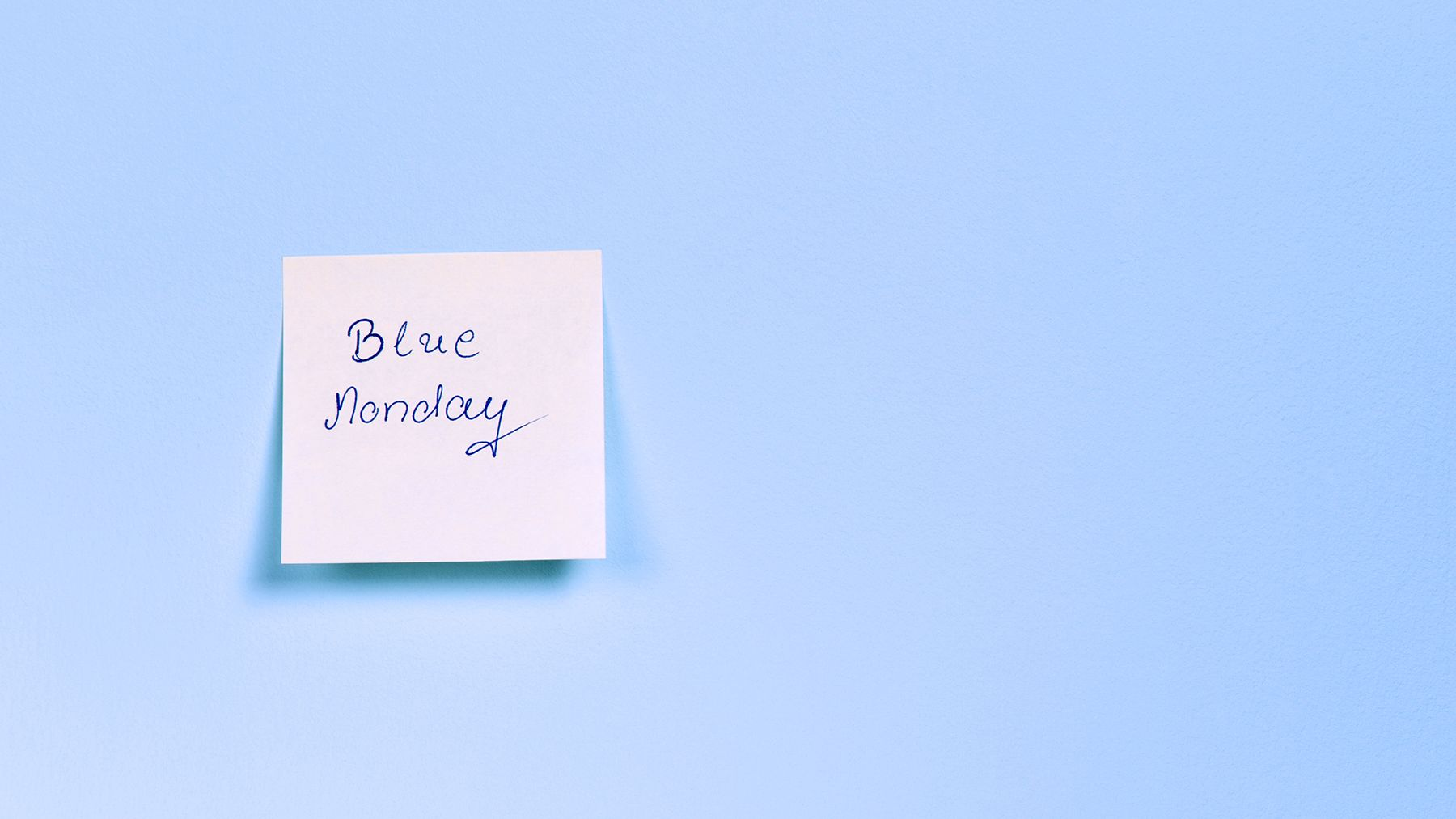blue background, white sticky note with 'Blue Monday' written on it