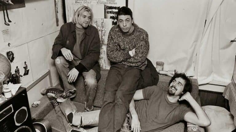 Converse advertisement of Nirvana wearing all star Chuck Taylor shoes.