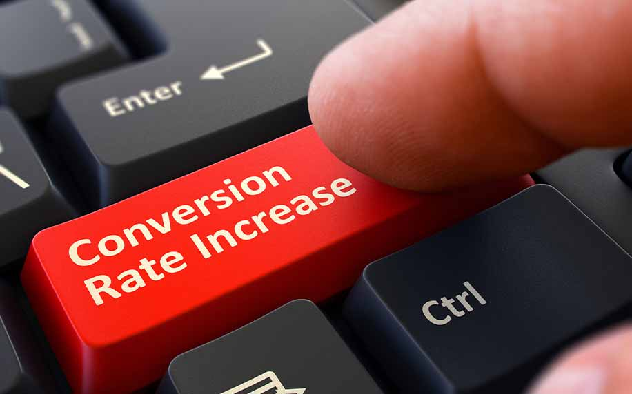 someone pressing a fake red conversion rate increase button