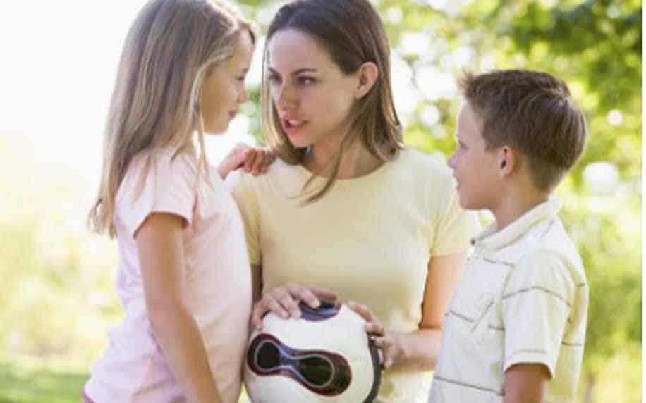 a woman and two children representing different demographics in market segmenation
