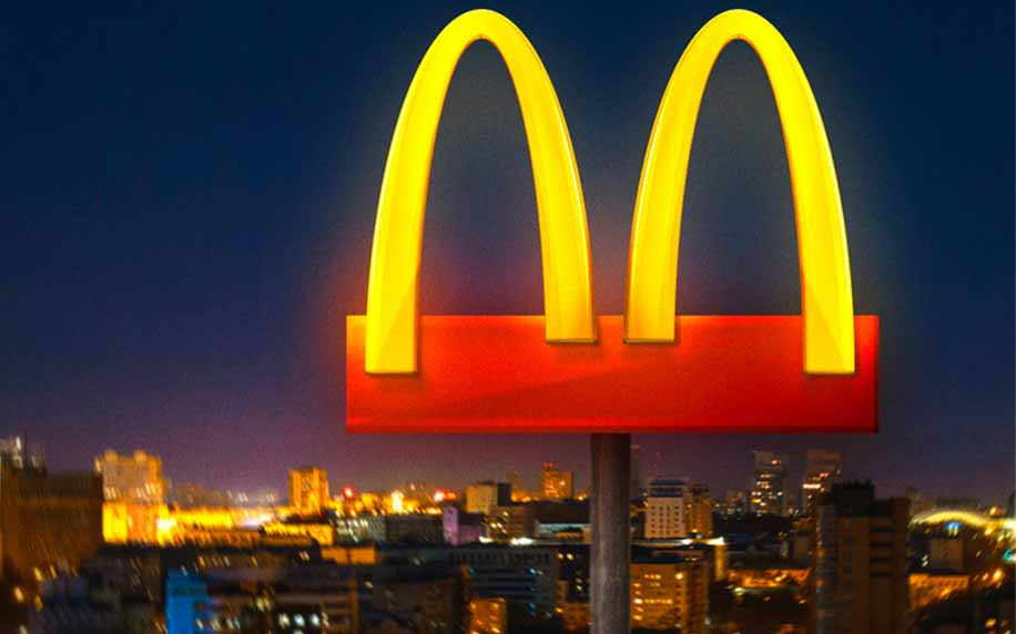 the mcdonalds sign with the m separated in a poor ad attempt to support staying apart for covid-19