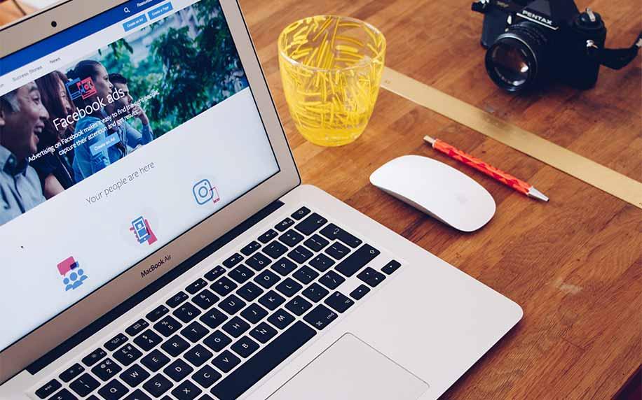a laptop open on facebook reading to begin a social media checklist