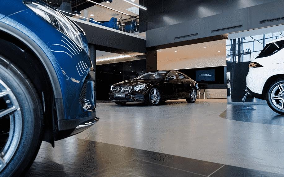 side of blue mini in car dealership