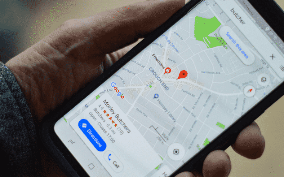 hand holding phone with Google map on screen showing local SEO