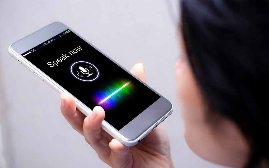 person using voice search on apple iphone