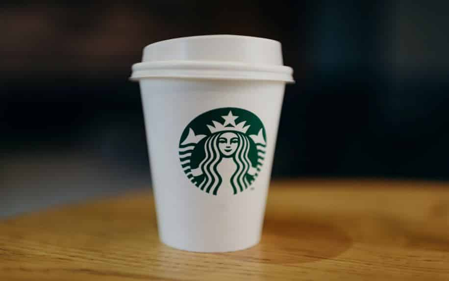 A Starbucks cup with their iconic green logo.