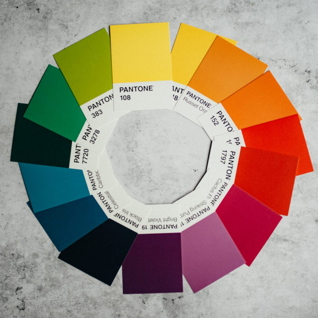 A colour wheel made out of Pantone brand colour swatches