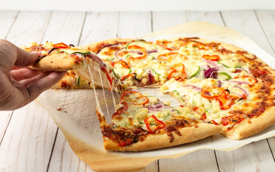 A cheese pull on a pizza is a great way to get restaurant video marketing content.