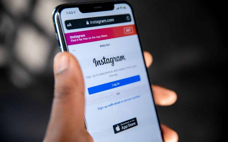 A smartphone with the login page of Instagram on the screen