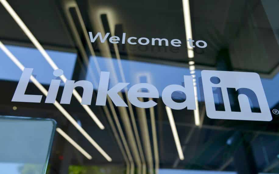 A photo of the LinkedIn logo on the window outside their office headquarters.