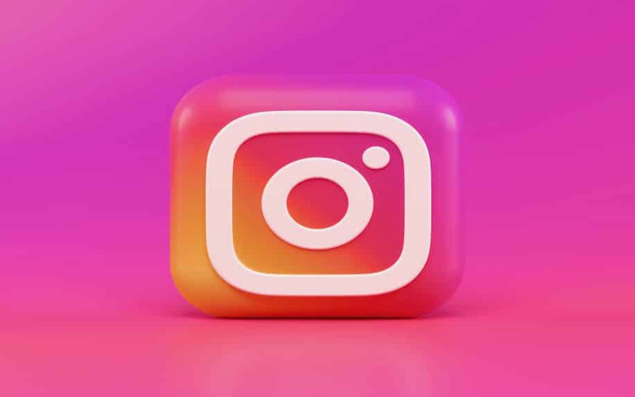 A 3D render of the Instagram logo with a pink background