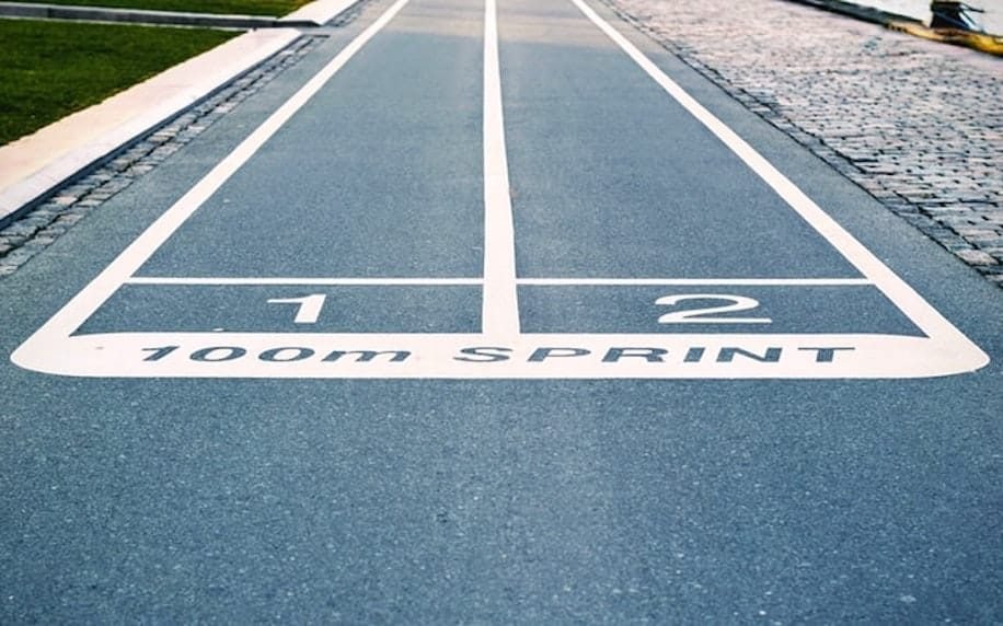 Image of two lanes of a running track to denote competition.