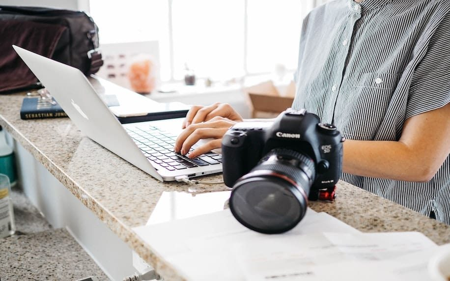 A image of photographic equipment and a laptop to denote the production of content.